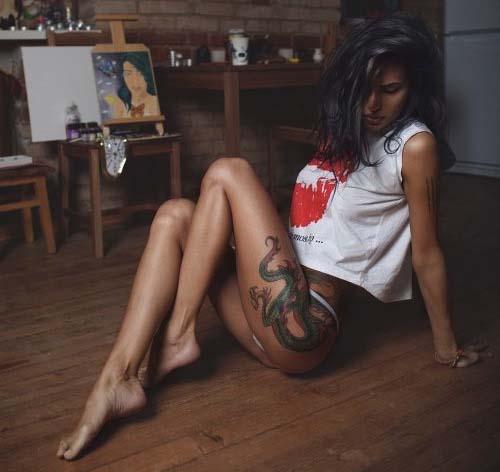 Leggy tattooed brunette babe